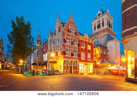 Night canal, typical dutch house, City Hall and Gothic Protestant Nieuwe Kerk, New church, in Delft, Holland, Netherlands