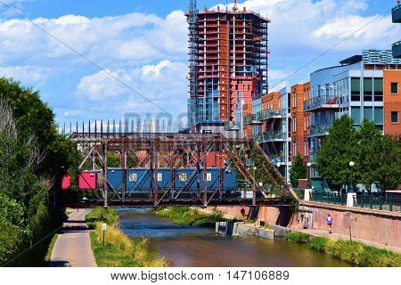 Denver, CO - September 12, 1016:  South Platte River Trail which is a 17 mile recreational trail through downtown Denver to Englewood and where people can walk or jog in a greenbelt riparian area beside the South Platte River in an urban neighborhood.