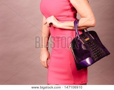 Elegant Mid Aged Woman In Dress With Bag.