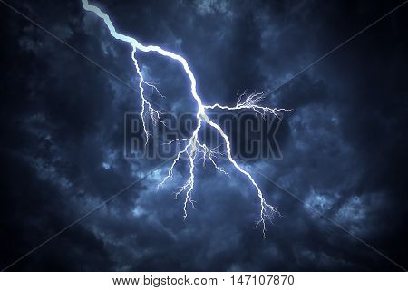 Lightning strike on the cloudy dark sky.