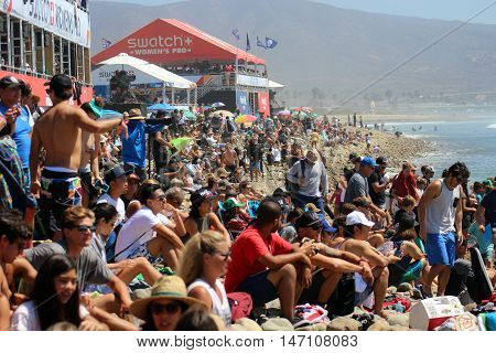 San Clemente, California, 9/10/16--Large beach crowd enjoys perfect weather at surfing contest at Lower Trestles, San Onofre State Park.