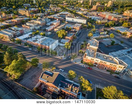 FORT COLLINS, CO, USA - SEPTEMBER 11, 2016: Downtown of Fort Collins, Colorado at late summer sunrise - aerial view with wide angle distortion.