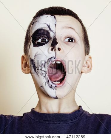 little cute boy with facepaint like skeleton to celebrate halloween, lifestyle people concept, children on holiday close up