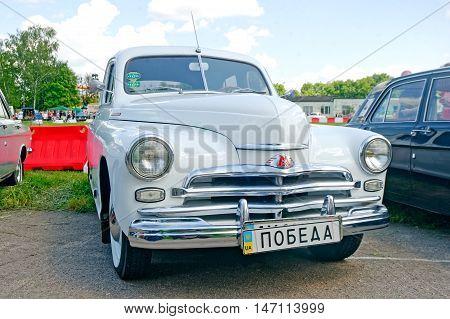 Kharkiv Ukraine - May 22 2016: Soviet retro car white GAZ M20 Pobeda Third Series manufactured between 1955 and 1958 exhibited at the festival of vintage cars Kharkiv Retro Rally - 2016 in Kharkiv Ukraine on May 22 2016