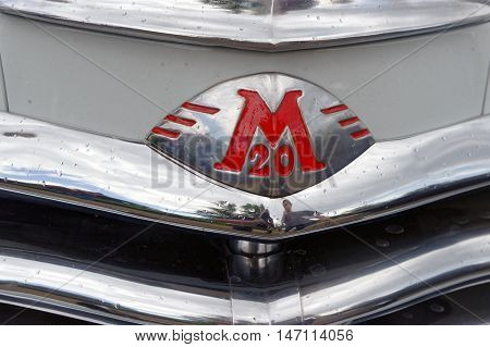 Kharkiv Ukraine - May 22 2016: Close up of the Soviet retro car white GAZ M20 Pobeda Third Series manufactured between 1955 and 1958 exhibited at the festival of vintage cars Kharkiv Retro Rally - 2016 in Kharkiv Ukraine on May 22 2016