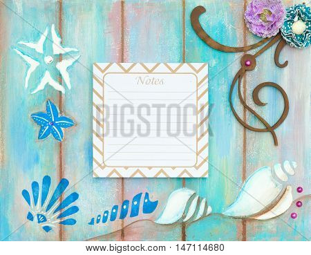 Blank beach note on wooden background decorated with sea shells copy space