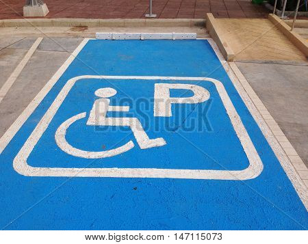 Disabled parking sign. Parking for disabled handicapped citizens. Empty parking lot