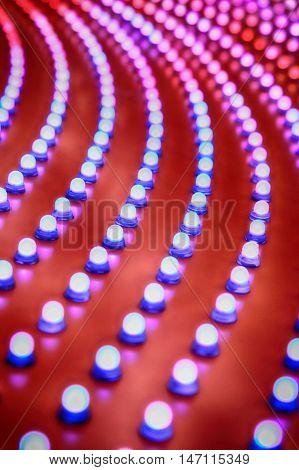 Picture of rows of theater marquee lights.