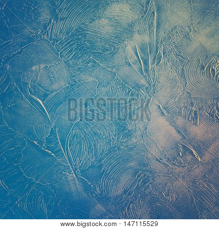 Decorative plaster. Abstract pattern in blue tones.