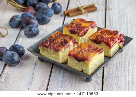 Plum Cake With Cinnamon On Small Baking Tray On White Table