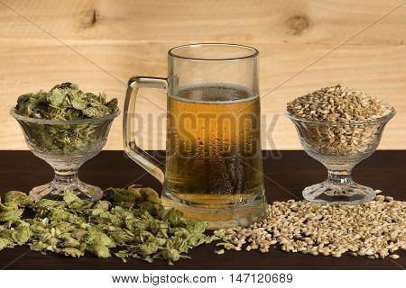 A mug of cold beer, hops and malts