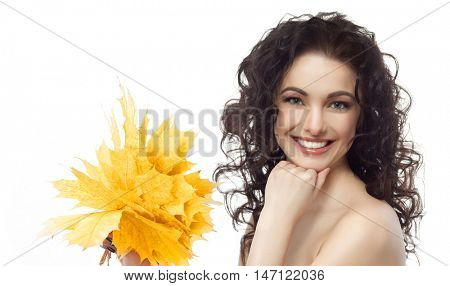 closeup portrait of attractive  caucasian smiling woman brunette isolated on white studio shot lips toothy smile face hair looking at camera tooth hand holding yellow marple autumn leaves