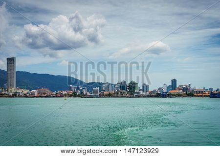 Penang, Malaysia - circa September 2016: View of George town, Penang, Malaysia from ferry to Butterworth. George town is the capital city of the Malaysian state of Penang. George town is a UNESCO heritage site and a popular tourist destination.