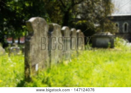 Grave Stones Outside A Church In Beaconsfield, Buckinghamshire, England Out Of Focus.