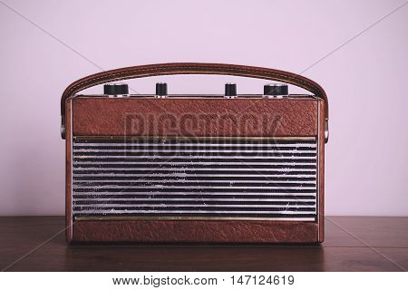 Old Retro Style Radio On A Wooden Surface Vintage Retro Filter.