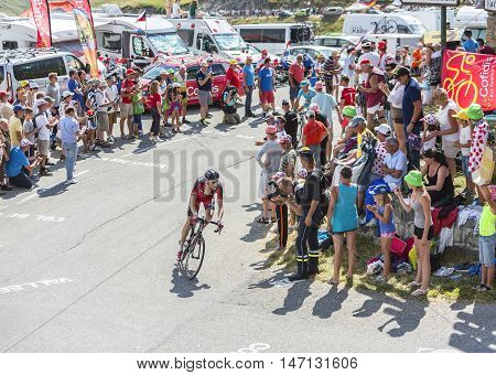 Col du Glandon France - July 23 2015: The Swisscyclist Michael Schar of BMC Racing Team riding in a beautiful curve at Col du Glandon in Alps during the stage 18 of Le Tour de France 2015.