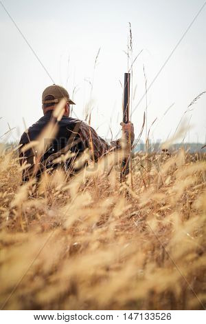 Hunter aiming the hunt during the hunting season