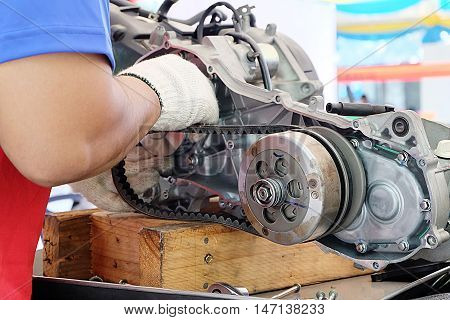 Hands of disassembly kit motorcycle in repair service. Automotive engine disassembly kit motorcycle.