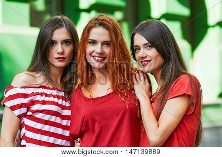 Three beautiful girls sisters portrait outdoor city