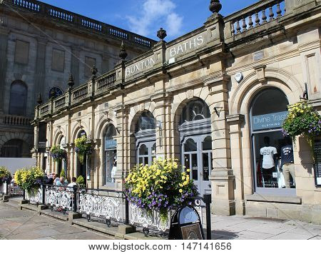 BUXTON, ENGLAND, AUGUST 27 2016: View of the former spa baths of Buxton which now houses the stylish Cavendish Shopping Arcade. A popular retail destination for locals and tourists.