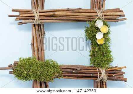 Easter frame with two raw quail eggs and empty blue field