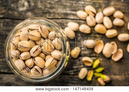 The pistachio nuts in jar. Top view.