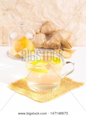 Ginger Tea With Lemon In A Glass Cup Rear Lemon And Ginger