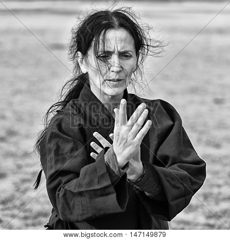 Woman doing Qi Gong high contrast, black and white image