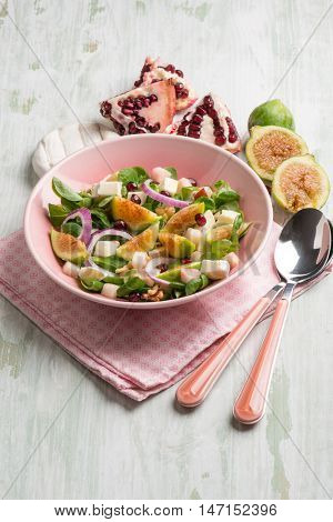 mixed salad with valerian figs cheese and pomegranate