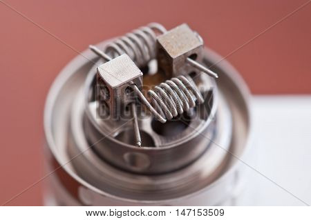 Macro photo of new clapton coil mounted in the electronic cigarette. poster