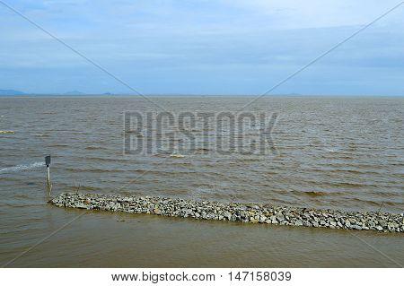 close up brown sea in Bang Poo, Thailand