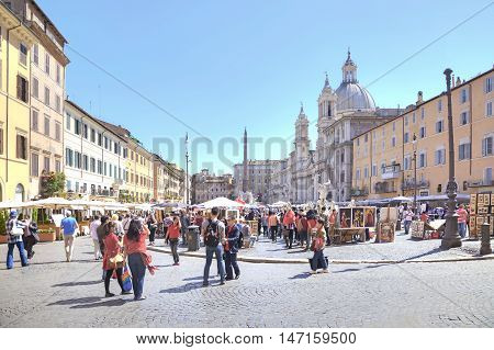ROME ITALY - May 03.2012: Tourists and citizens walking and photographed in Piazza Navona near the old fountain of Four rivers