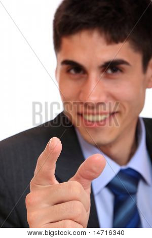 young business man in a suit pointing with his finger