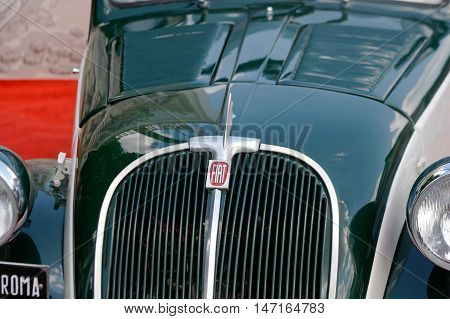 Kharkiv Ukraine - May 22 2016: Close up of retro car green Fiat Topolino manufactured between 1936 and 1955 is presented at the festival of vintage cars Kharkiv Retro Rally - 2016 in Kharkiv Ukraine on May 22 2016