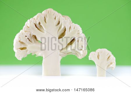 Cross section of cauliflower on green bacground