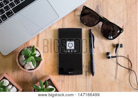 CHIANG MAI, THAILAND SEP 28, 2016 :Uber mobile apps. Uber - Company of San Francisco, established under the eponymous mobile application for searching, calling and paying a taxi or private drivers.