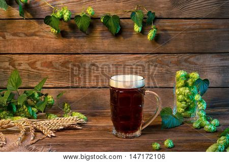 Beer glass with lager dark lager brown ale malt and stout beer on table in bar or pub still life with wooden background