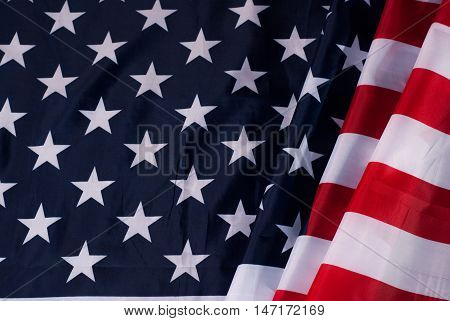 American flag flowing with texture fabric detail, the star-spangled canvas