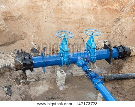Drink  Water Pipes Joined With New Blue Gate Valves And New Black Waga Multi Joint Members.