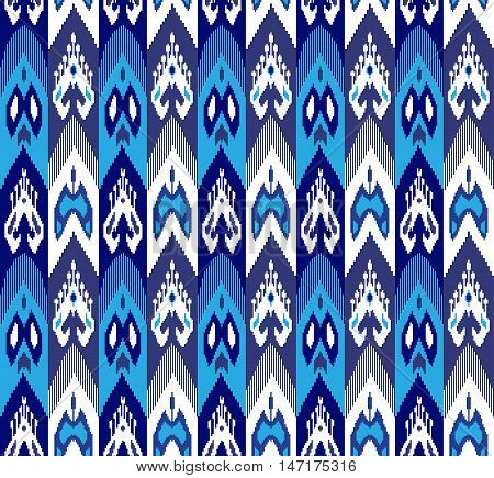 Ethnic seamless pattern with folk print. Stylized Uzbek silk textile