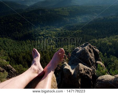 Naked Male Legs Take Rest On Peak. Outdoor Activities