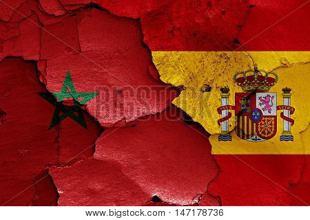 flags of Morocco and Spain painted on cracked wall