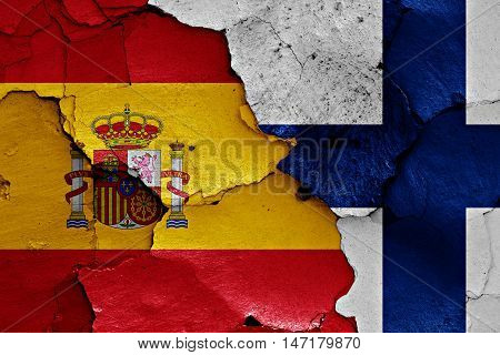 flags of Spain and Finland painted on cracked wall
