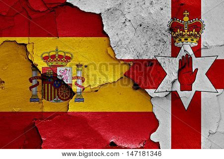 flags of Spain and Northern Ireland painted on cracked wall