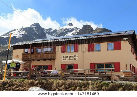 Valfurva, Italy - June 2, 2016: Alpine hut Rifugio Bonetta at gavia pass and mountain Monte Gavia. The gavia pass is one of the highets mountain passes in the Alps.