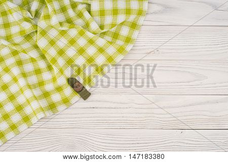 The green cloth on a white wooden table. Top view.