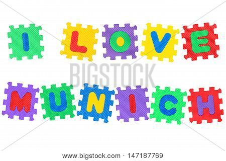 Message I Love Munichi from letters puzzle isolated on white background.