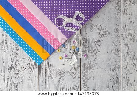 Cotton Fabrics For Sewing, Lace And Accessories For Needlework On Wooden Background. Set For Needlew