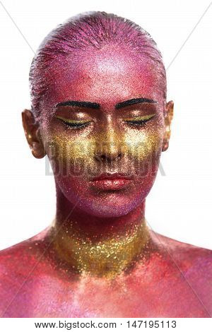 Glitter makeup on a beautiful woman face on a black background. Creative Contemporary Design