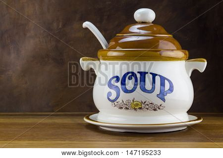 Soup tureen on wood table - Winter concept